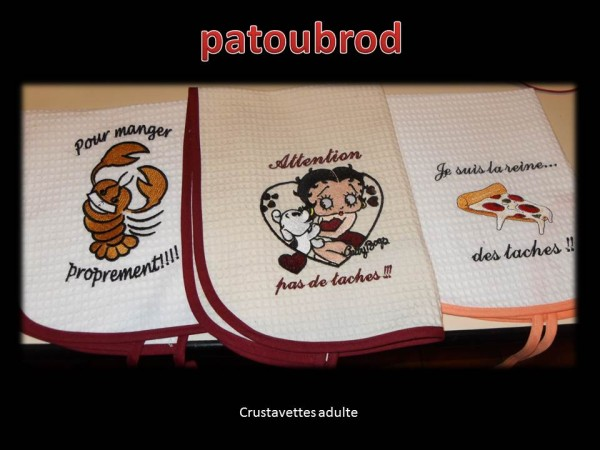 Betty Boop and crab designs embroidered on kitchen towels