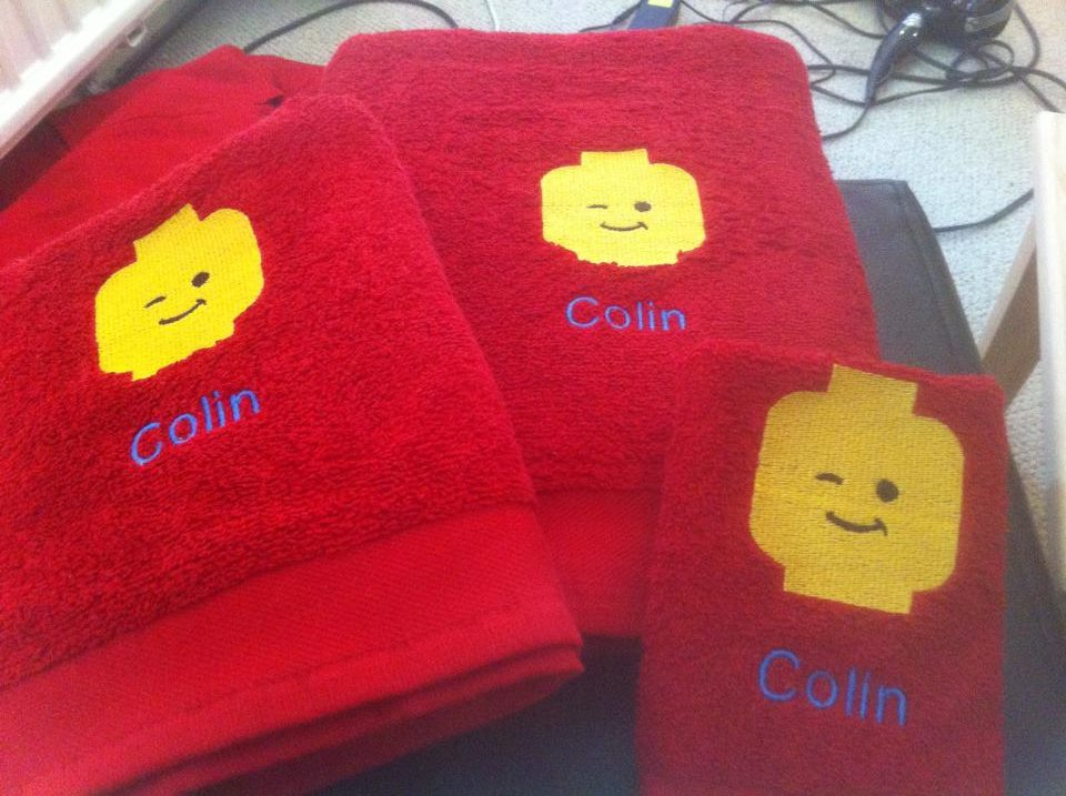 Lego head design on towel embroidered