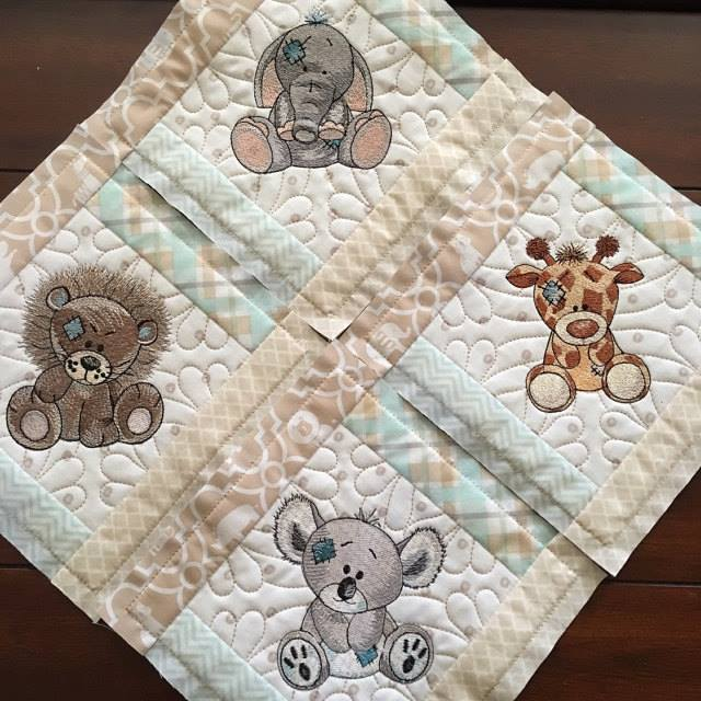 Blue nose friends embroidered on baby blanket