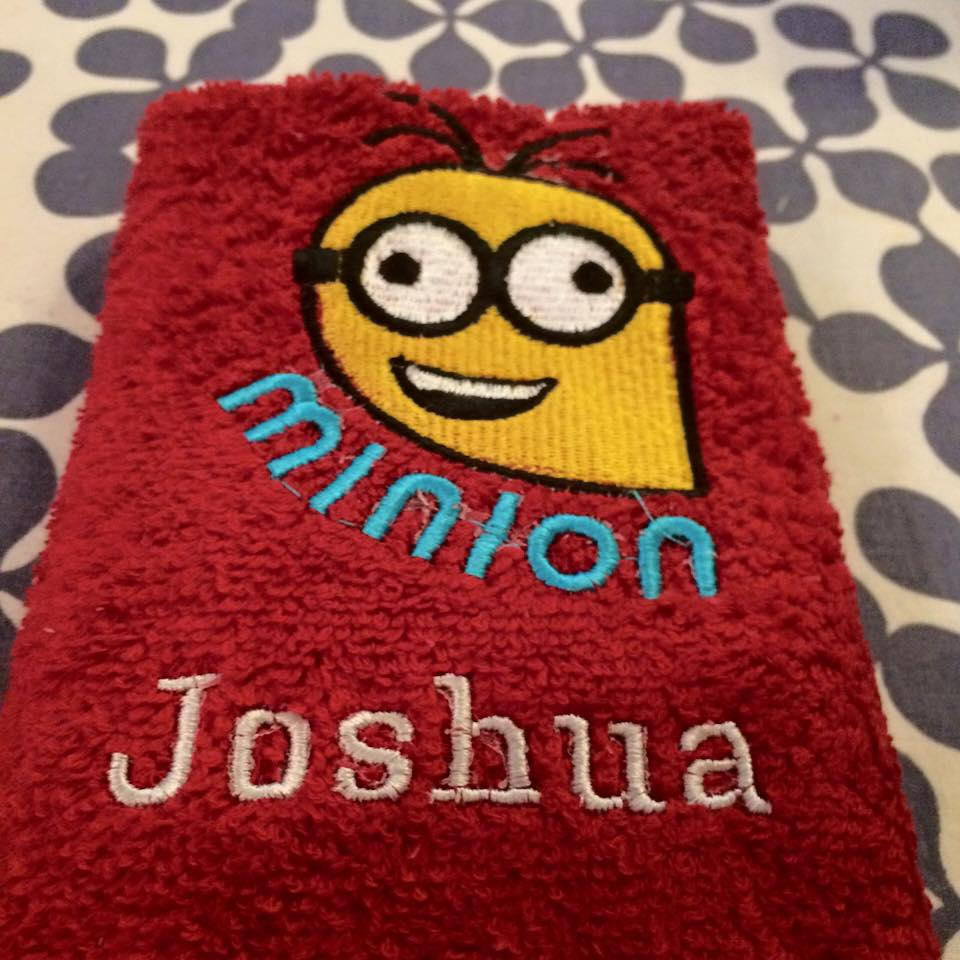 Red bath embroidered towel with Minion