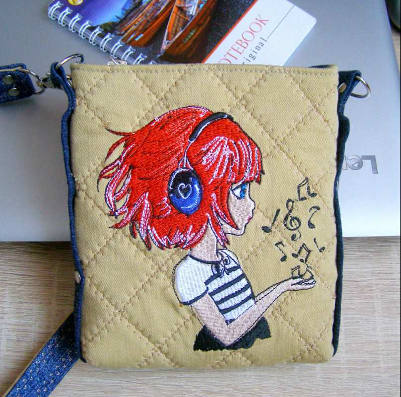 Embroidered small bag with red hair girl design
