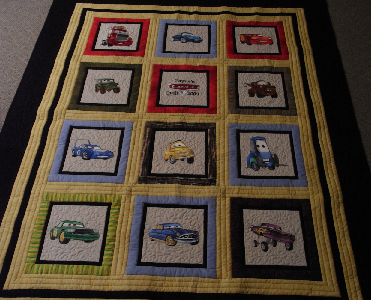 Embroidered Cars designs on quilt