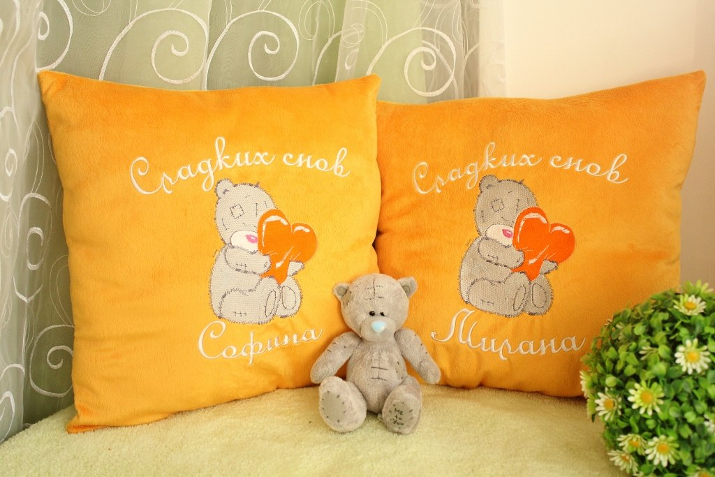 Teddy Bear with heart embroidered on yellow pillowcases