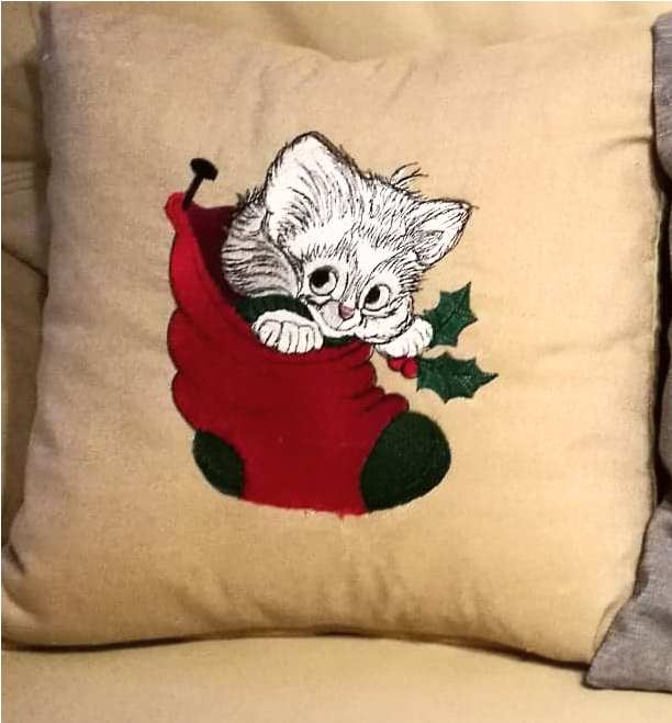 Embroidered cushion with christmas kitten design