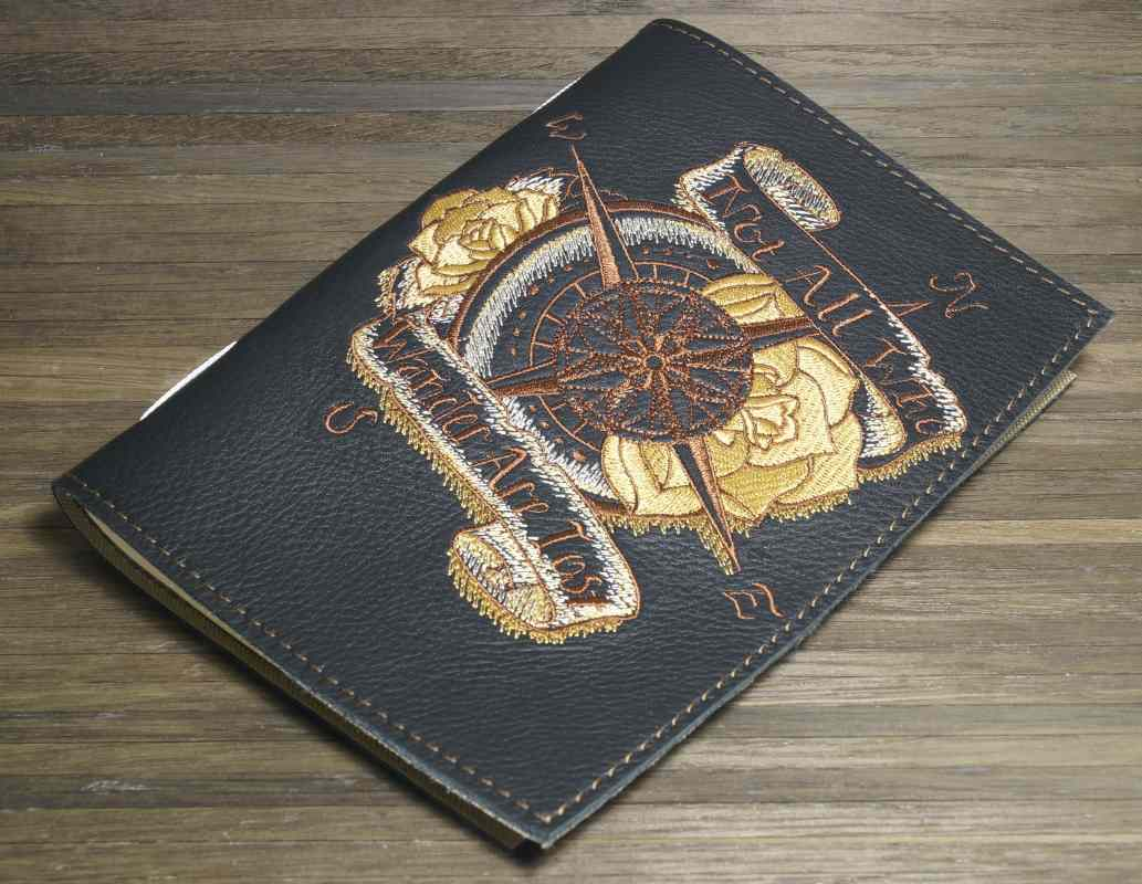 Leather cover with compass embroidery design