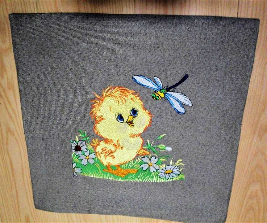 Embroidered item with chicken and dragonfly design