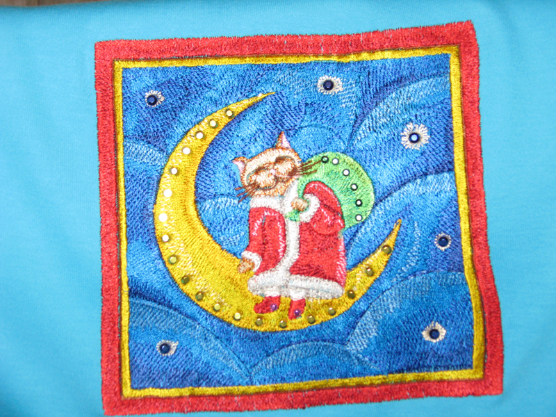 Christmas cat on the moon design on t-shirt embroidered