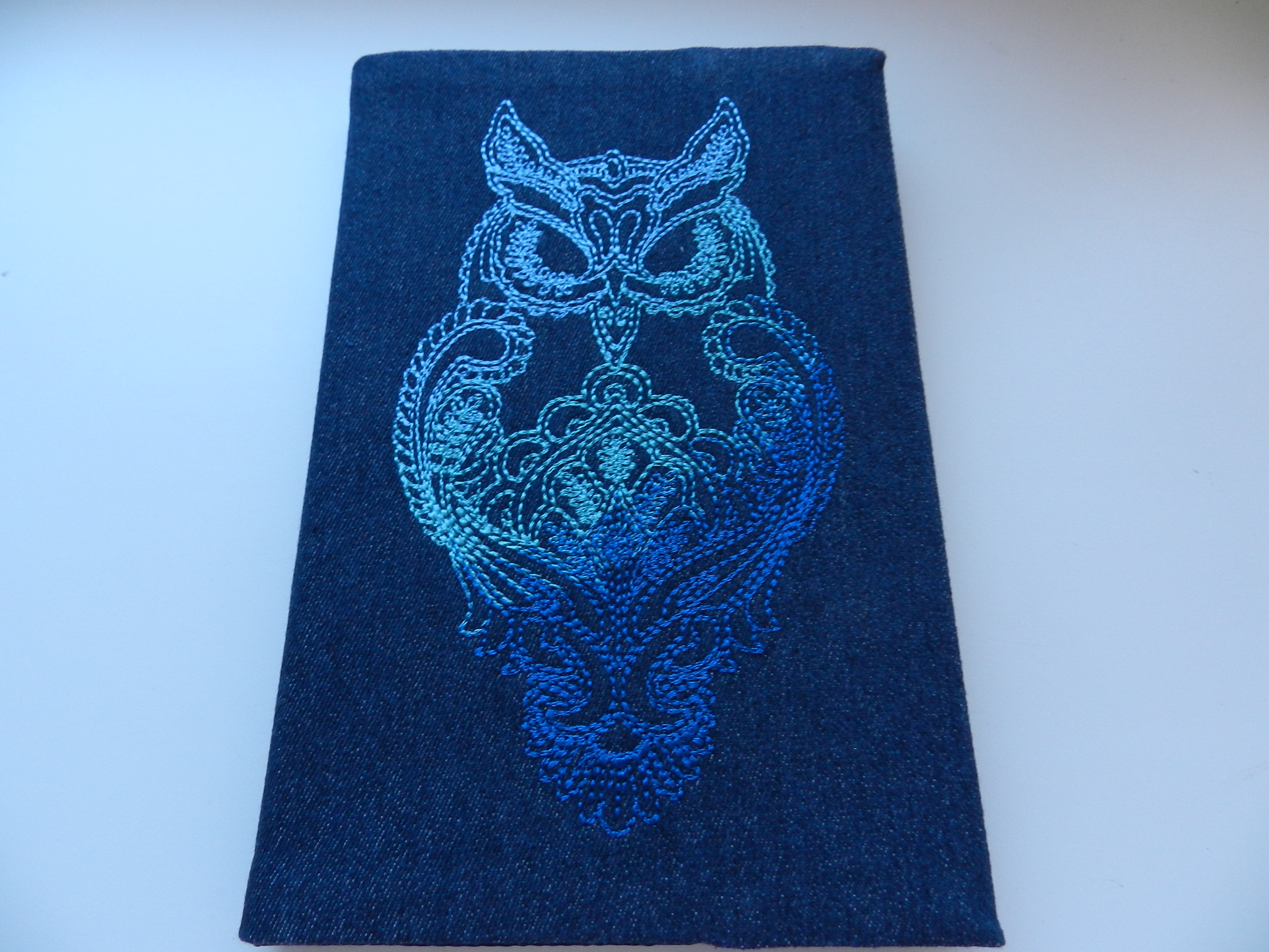 Embroidered book cover with owl