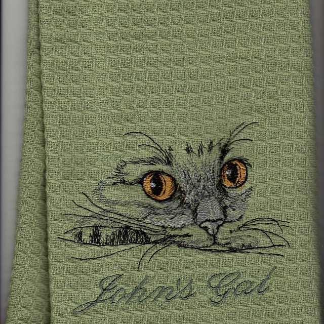 Towel with cat embroidery design