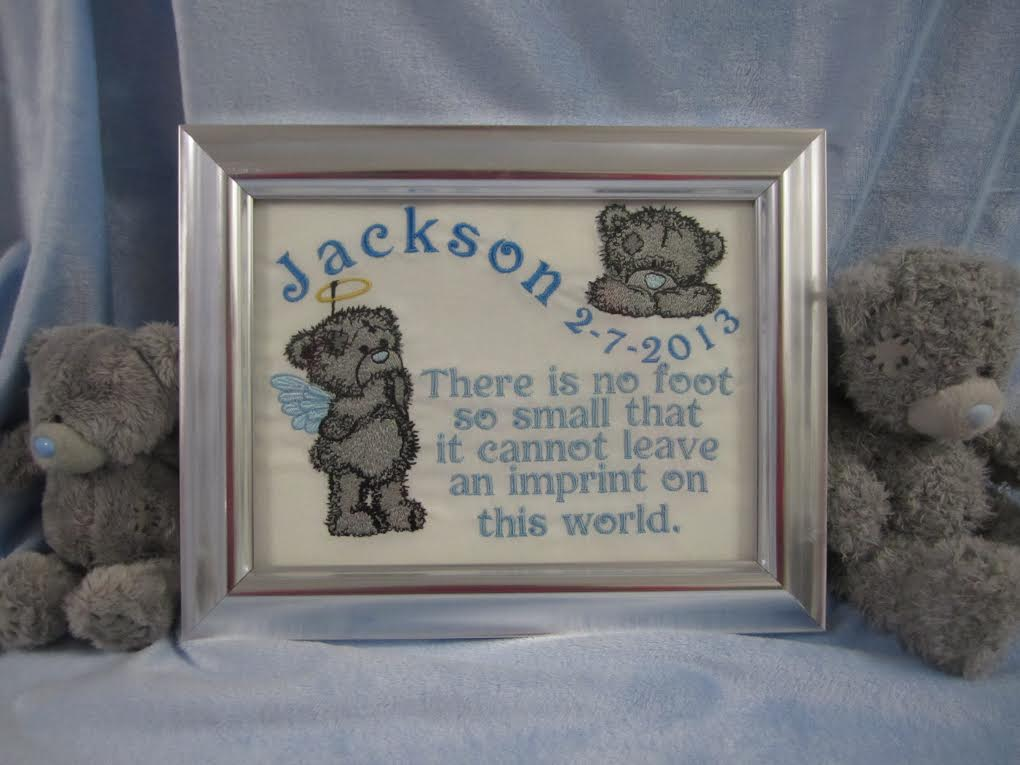 Teddy bear design embroidered on birth announcement frame