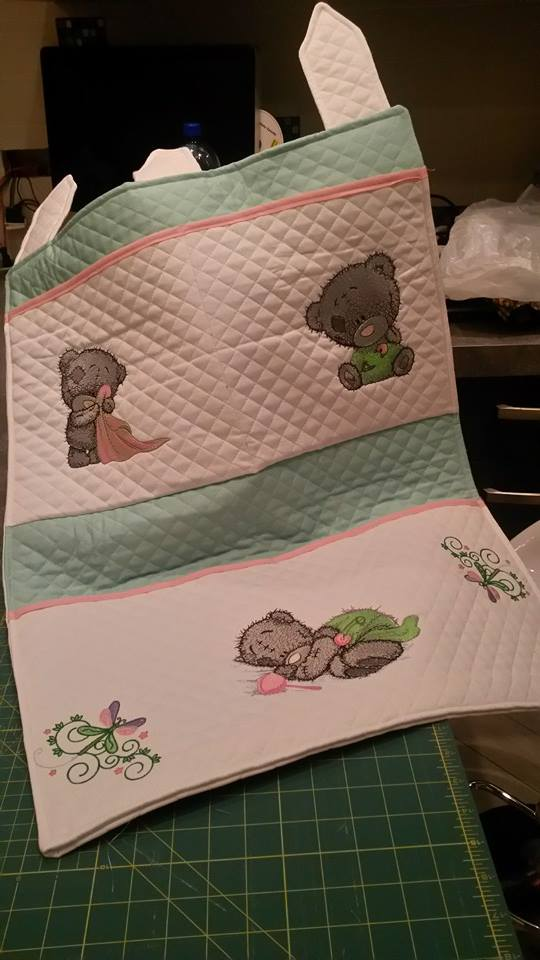 Baby tatty teddy bears embroidered on quilt