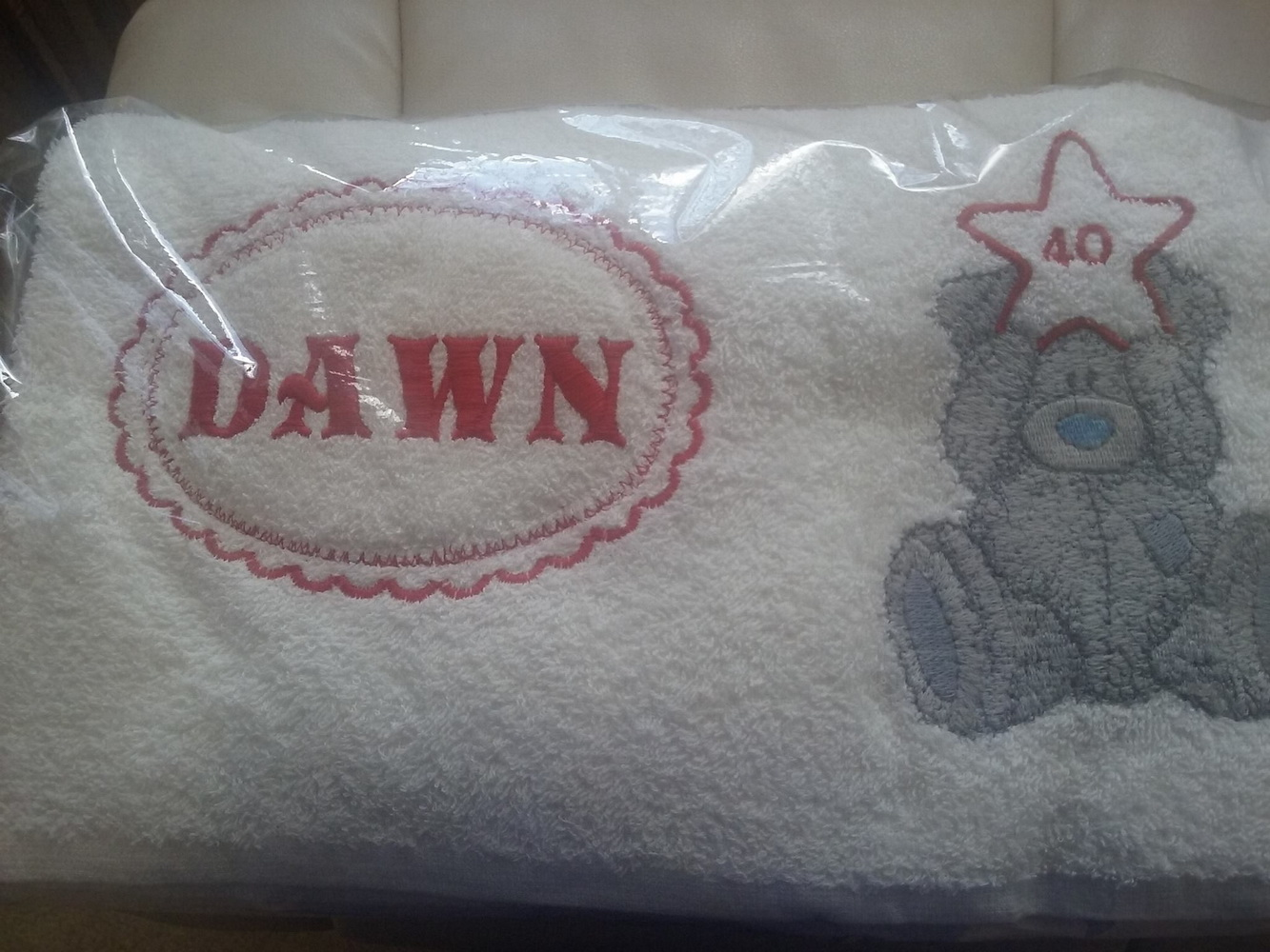 White towel embroidered with blue nose bear design