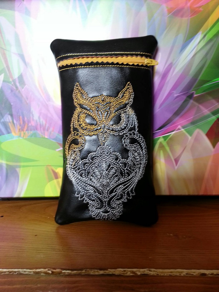 Black small leather bag embroidered with owl design