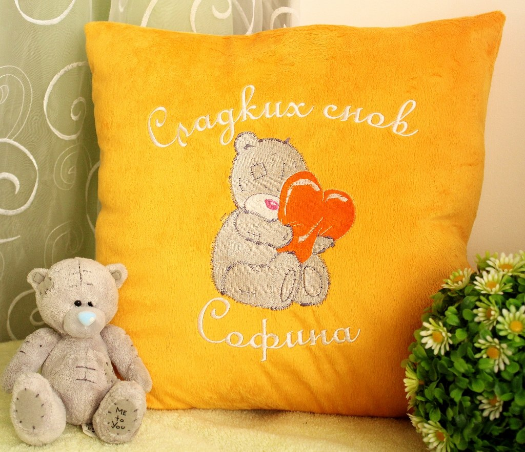 Bright yellow pillowcase embroidered with tatty teddy