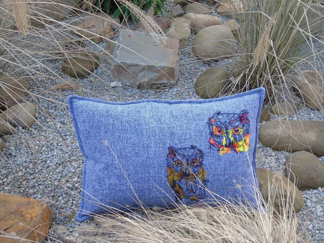 Embroidered cushion with owls sketch style design