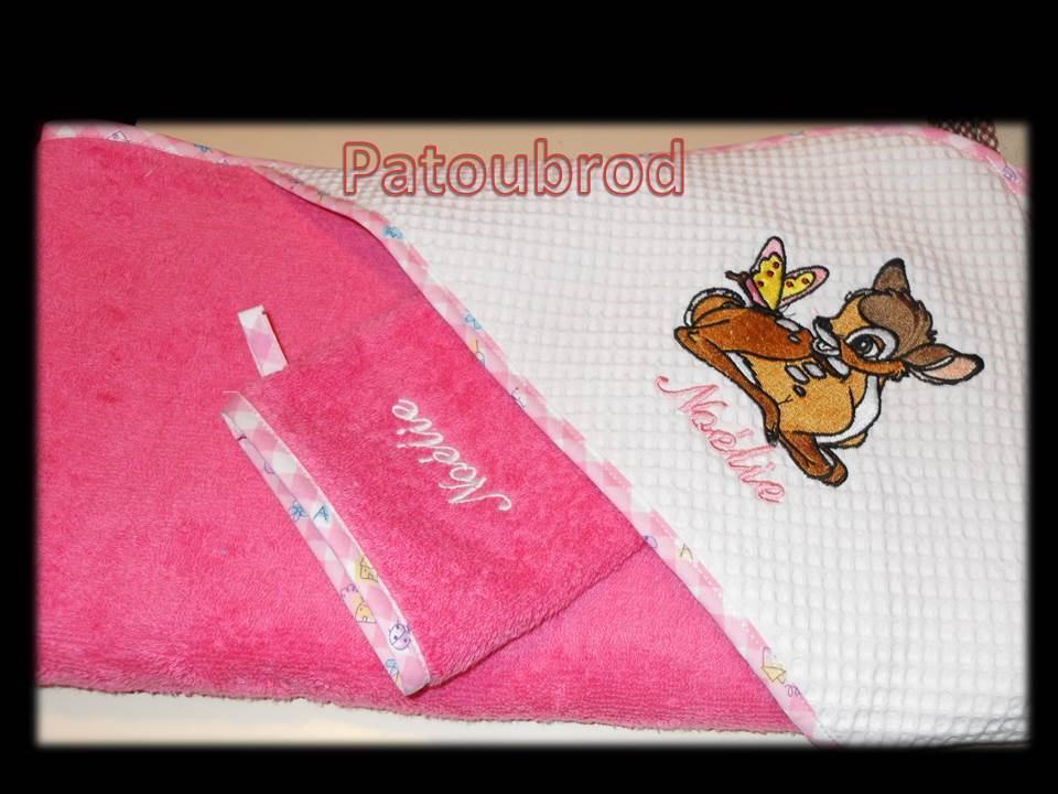 Embroidered Bambi and butterfly design on towel