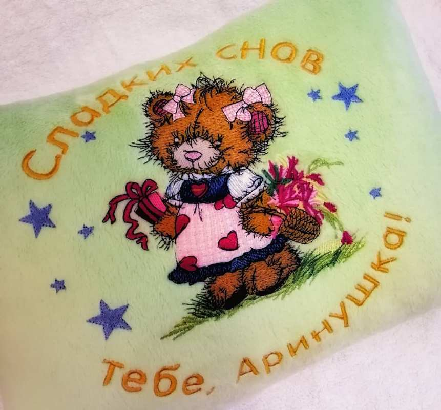 Cushion with teddy bear collecting flowers design