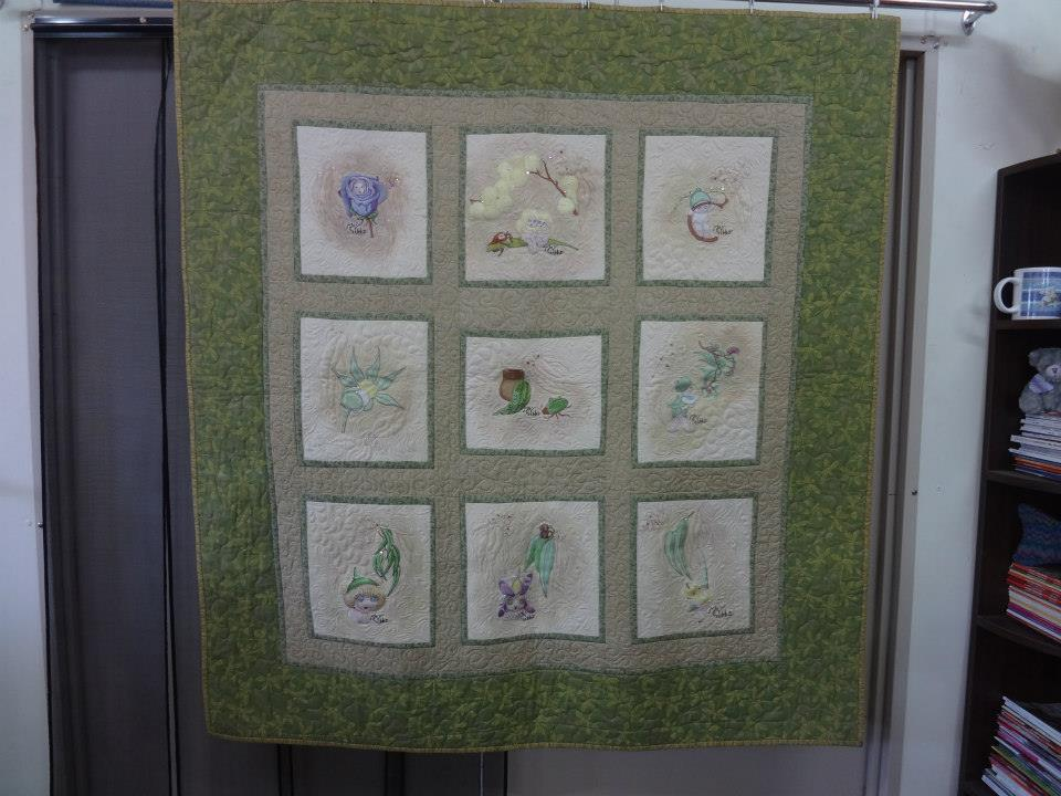 Embroidered quilt with Snugglepot and Cuddlepie
