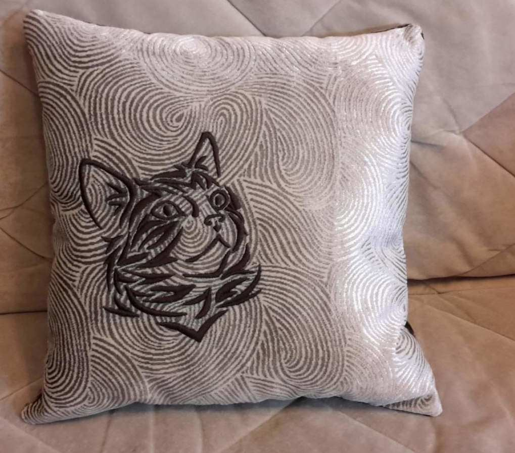 Cushion with tribal cat free embroidery design