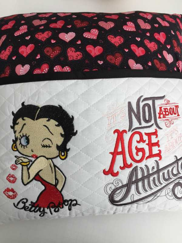 Embroidered cushion with Betty Boop love design