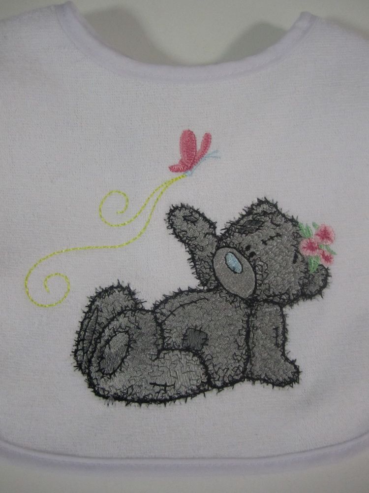 White bib with tatty teddy embroidered on it