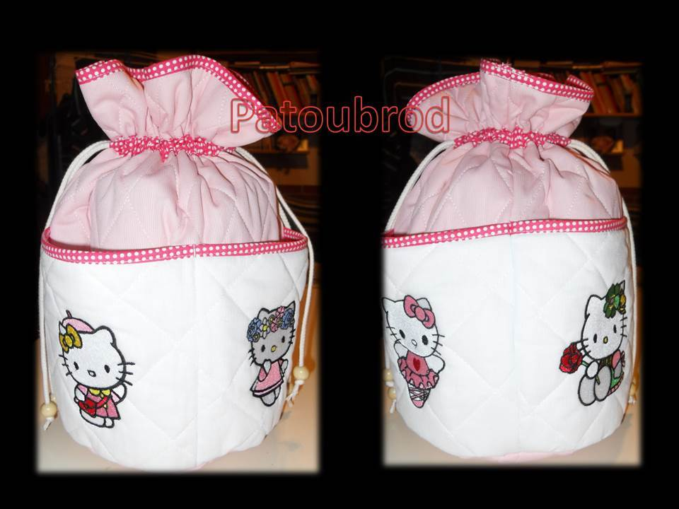 Hello Kitty designs embroidered on small textile bag