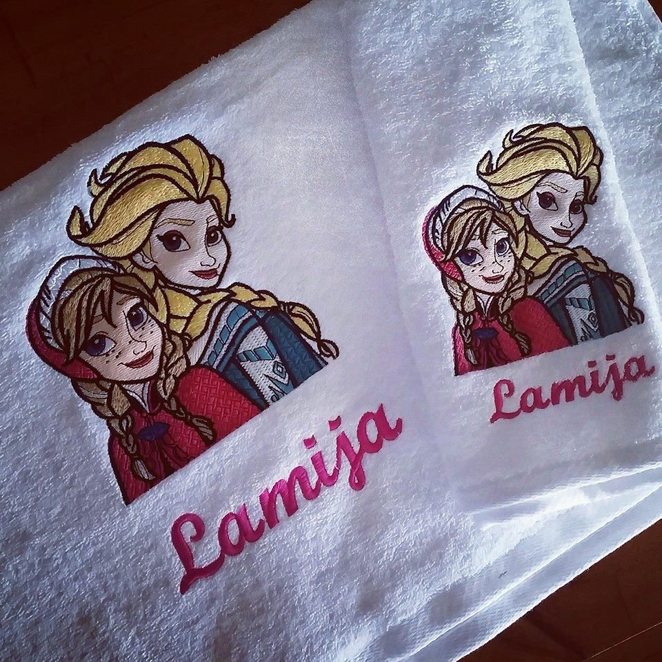 Two embroidered towels with Frozen sisters design