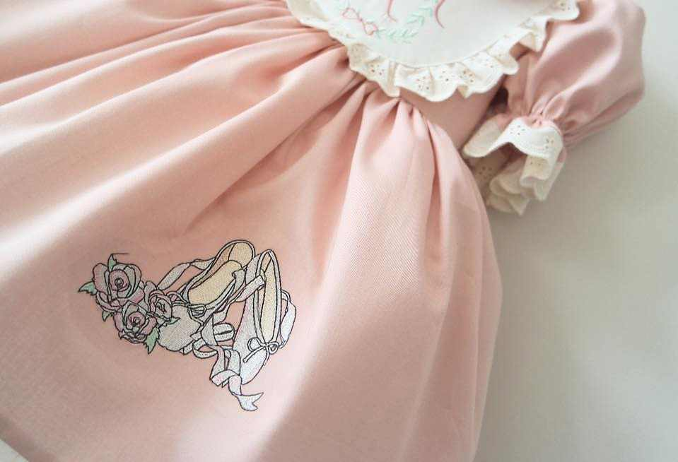 Embroidered dress with ballet shoes design