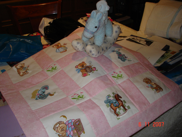 Girlish blanket embroidered with toys designs