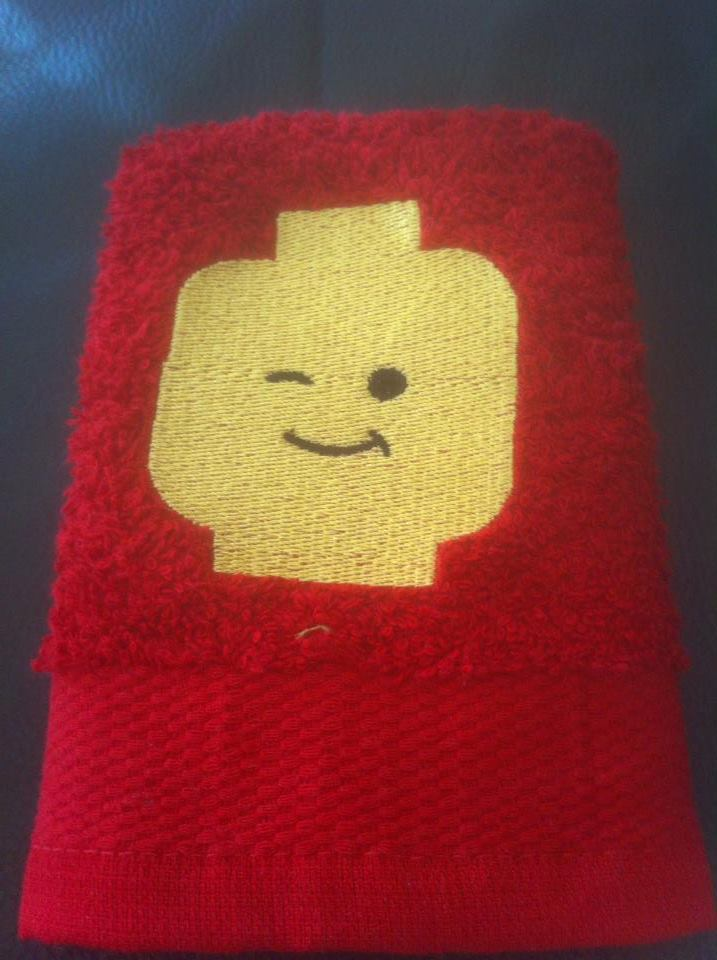 Embroidered Lego head design on towel