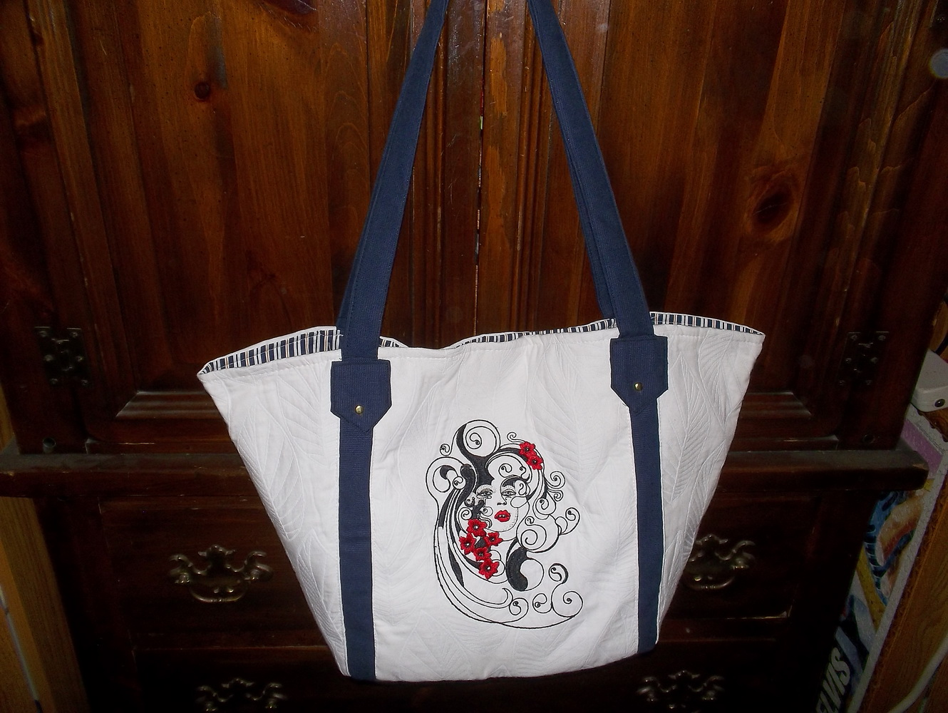 Woman face embroidered on summer bag