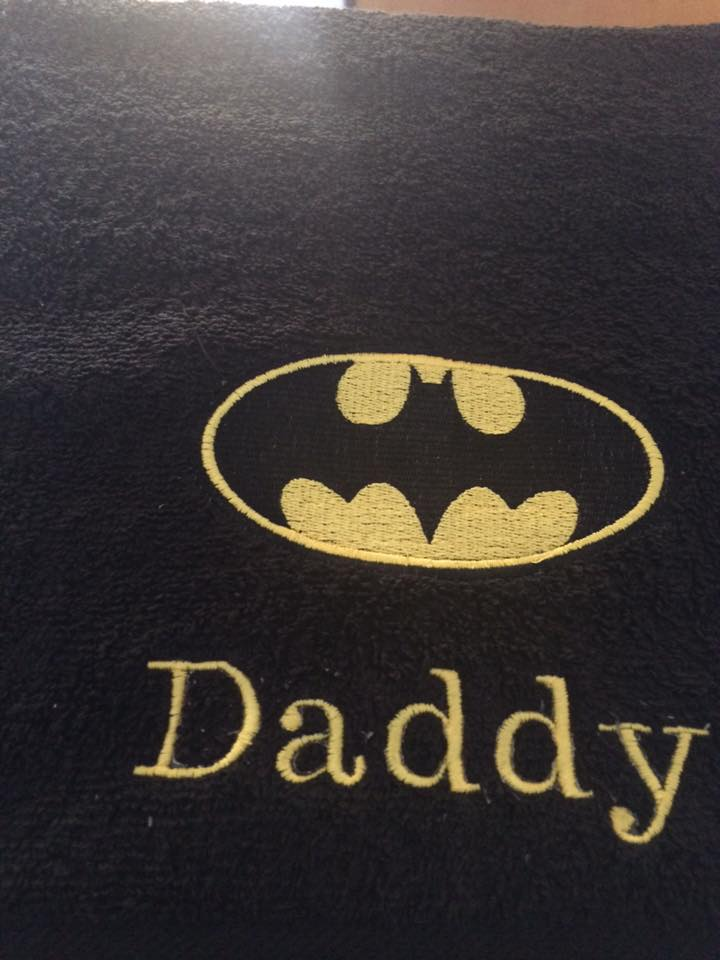 Embroidered Batman logo on bath towel