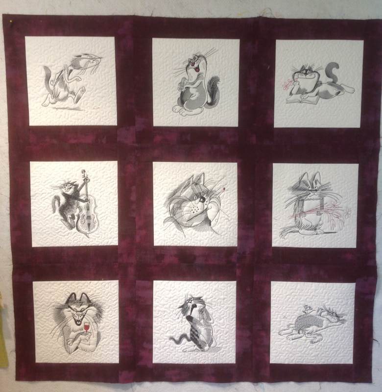 Big quilt with funny cats free embroidery designs