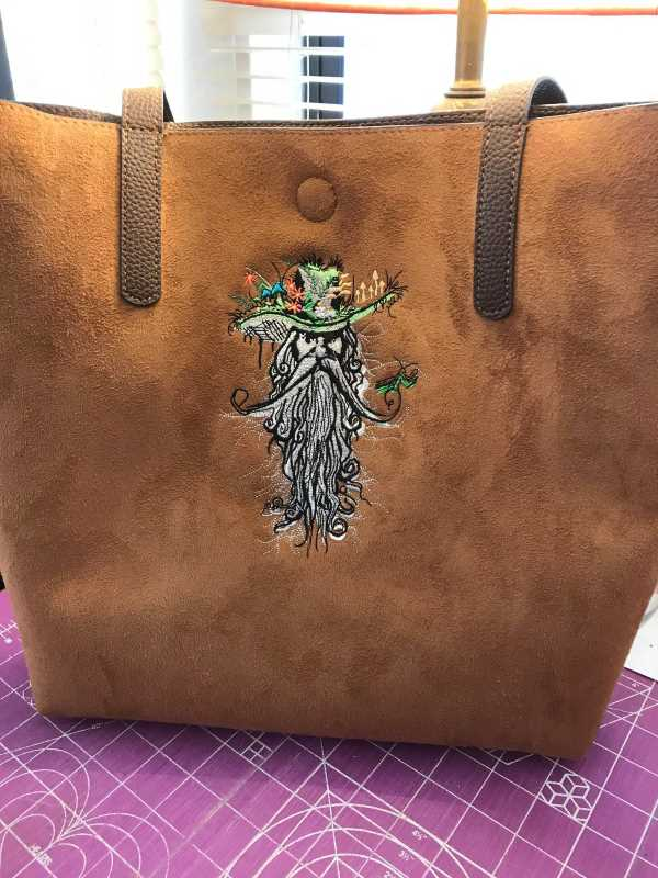 Leather bag with Root man embroidery design