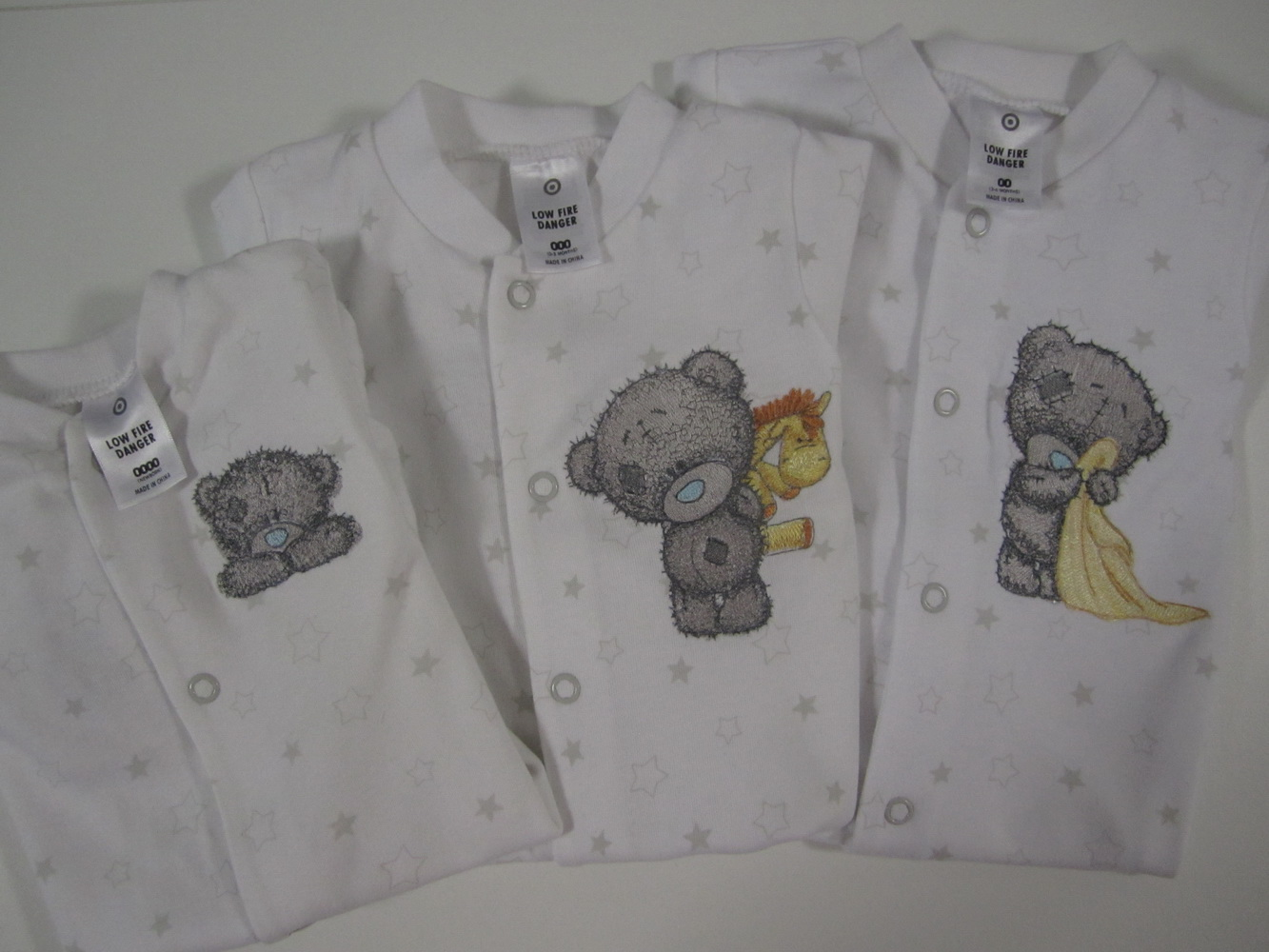 Teddy bear machine embroidery designs on baby wear