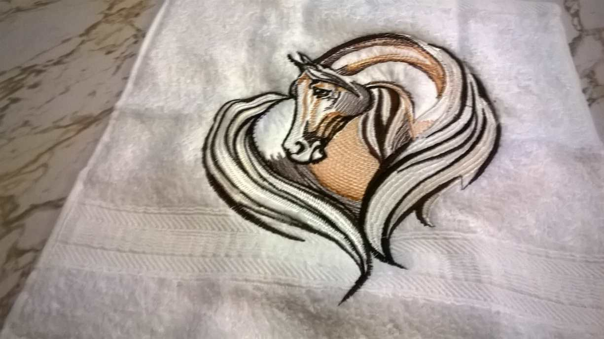 Towel with loving horse free embroidery design