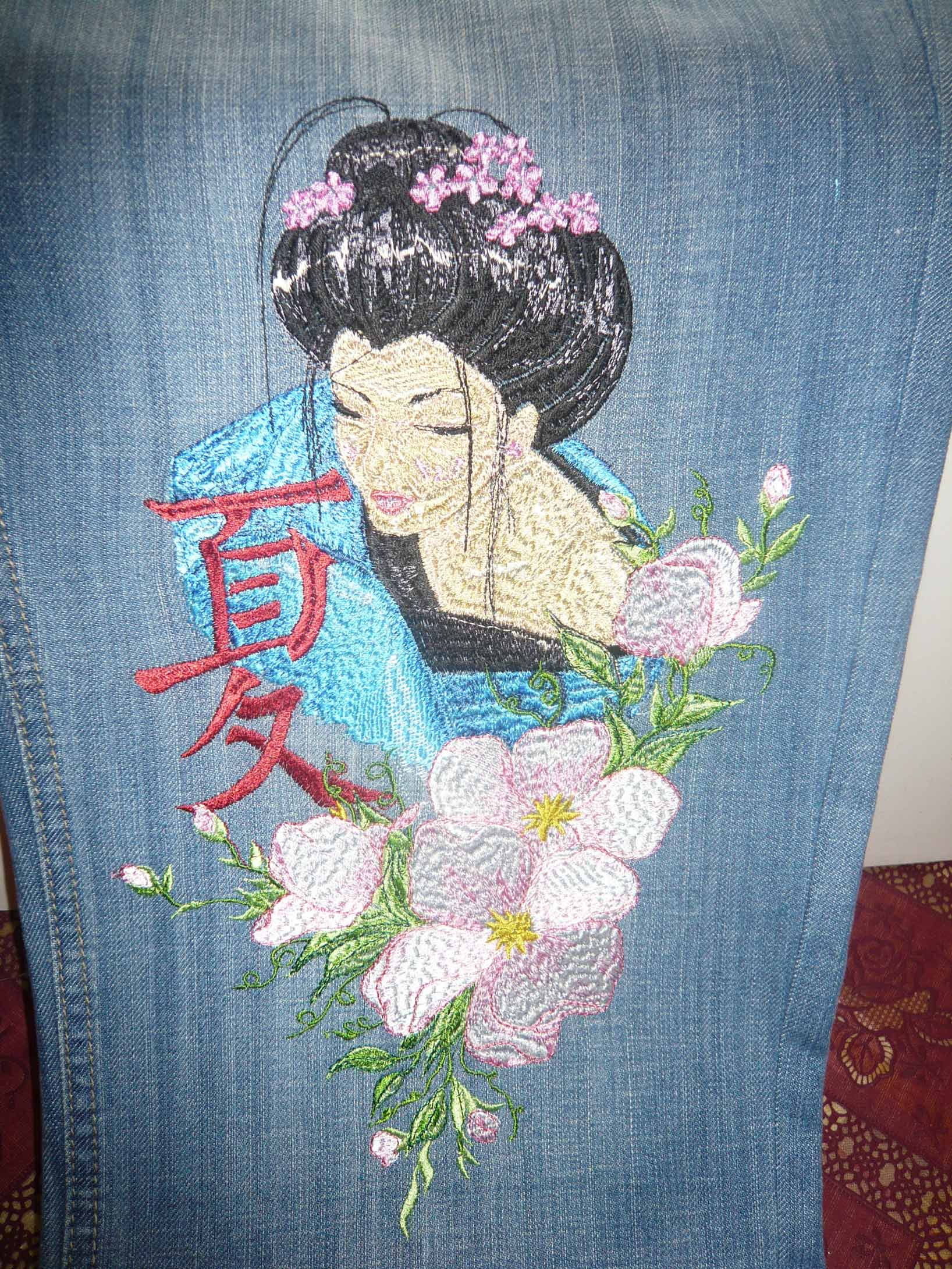 Geisha with hieroglyphic embroidery design on jeans