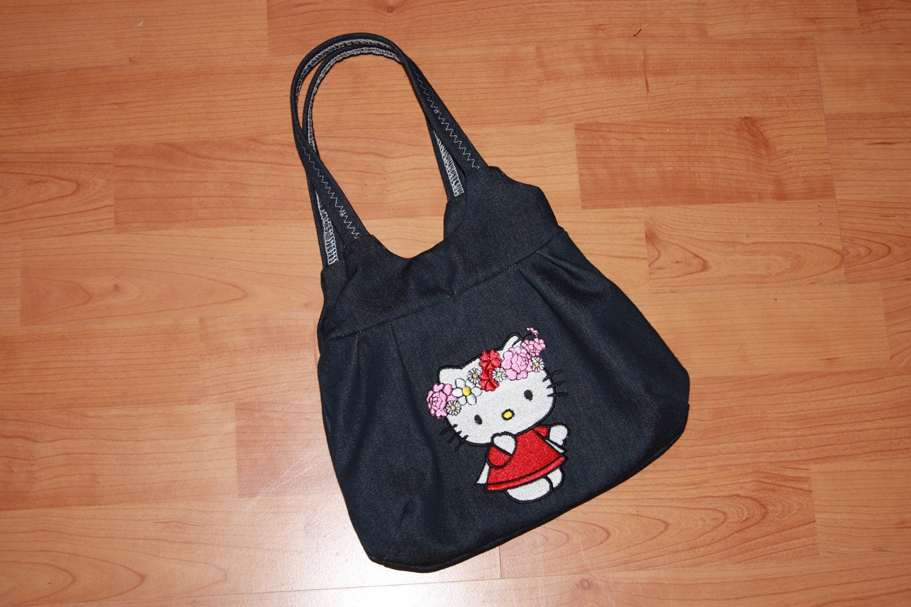 Black bag with embroidered Hello Kitty