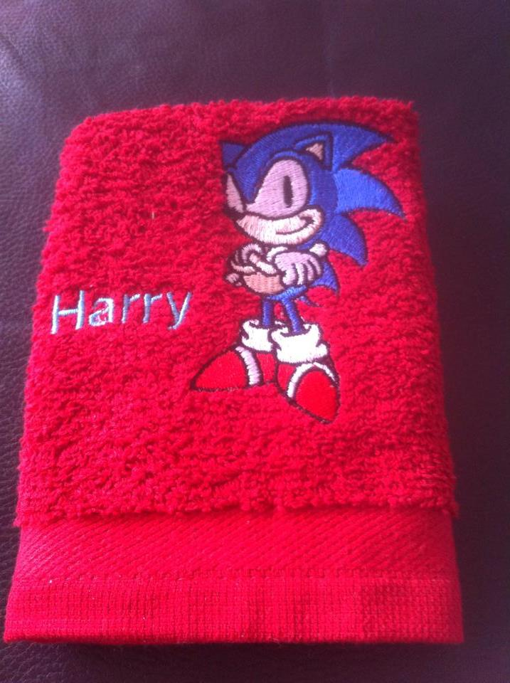 Sonic the Hedgehog embroidered on red bath towel