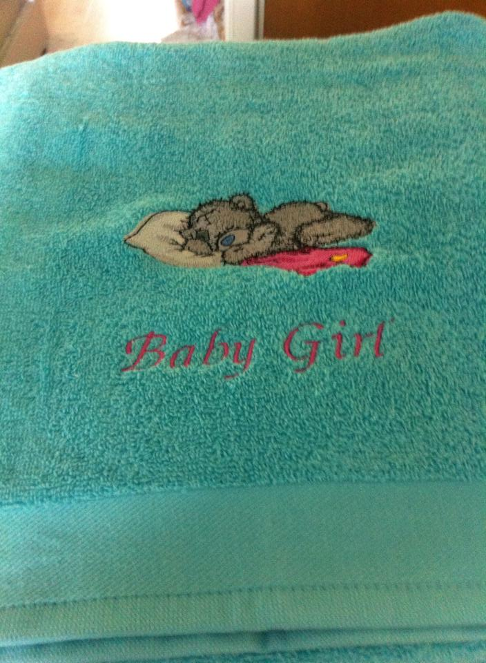 Blue bath towel with embroidered tatty teddy
