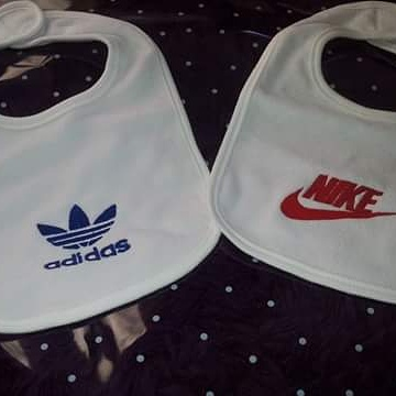 Nike and Adidas logos embroidered on bibs