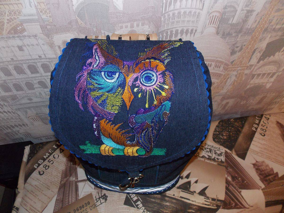 Embroidered blue bag with owl design