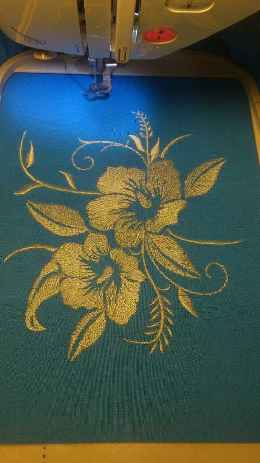 embroidery process with blue flowers free design