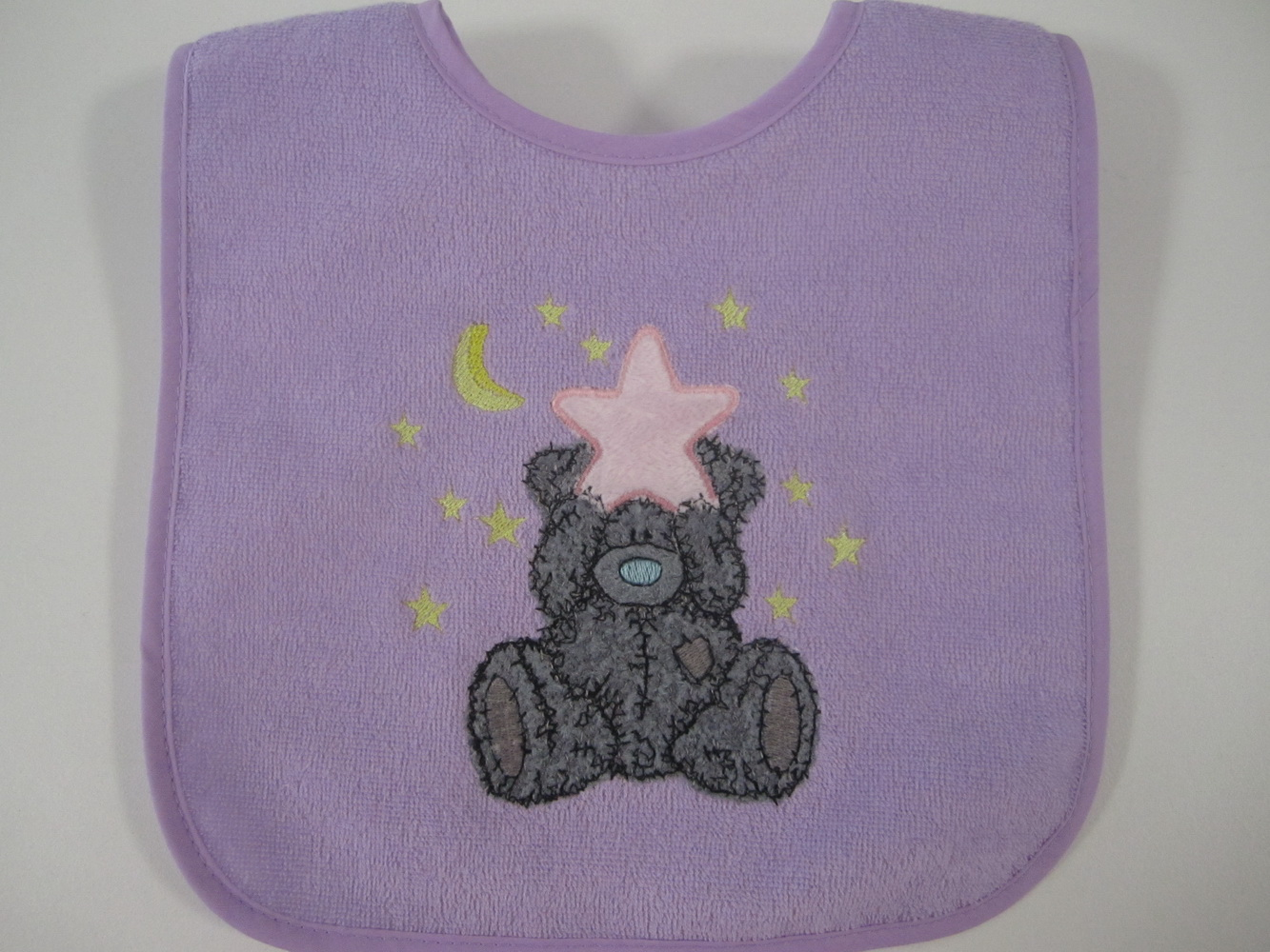 Teddy bear with big star embroidered on baby bib