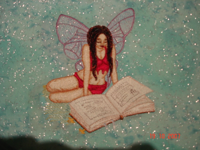 Fairy reading book design embroidered