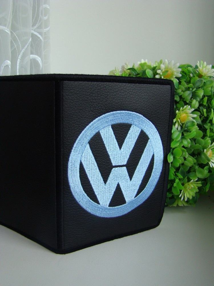 Embroidered Volkswagen logo on cover