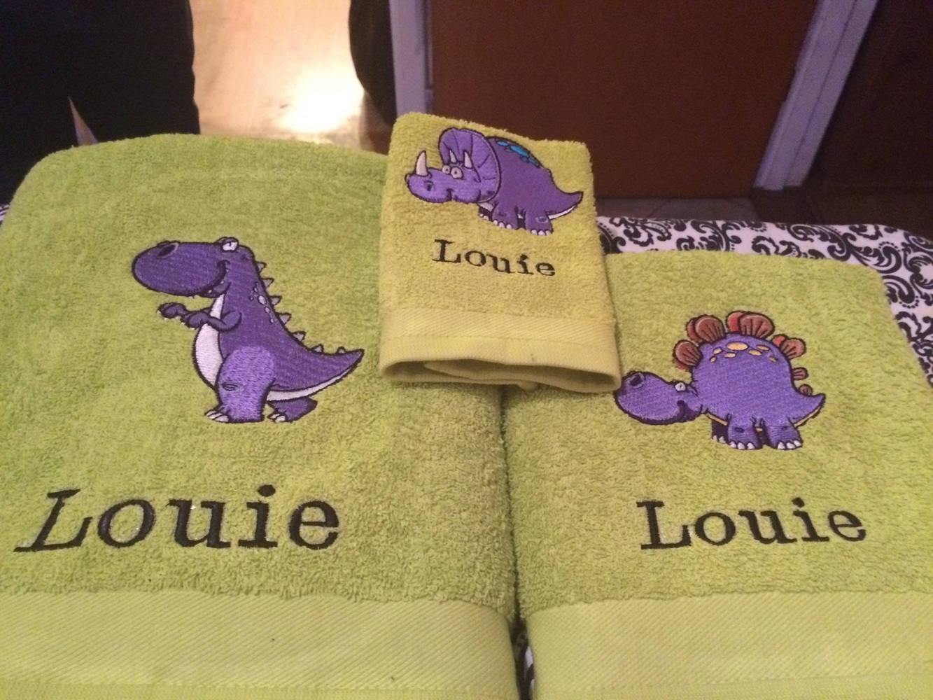 Dinosaurs embroidered on bath towels