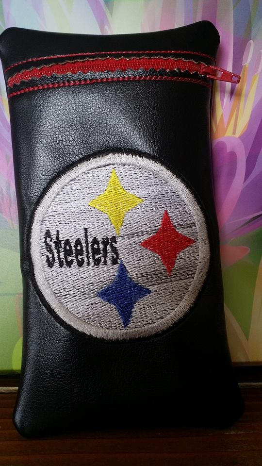 Black bag with embroidered Pittsburgh Steelers logo on it
