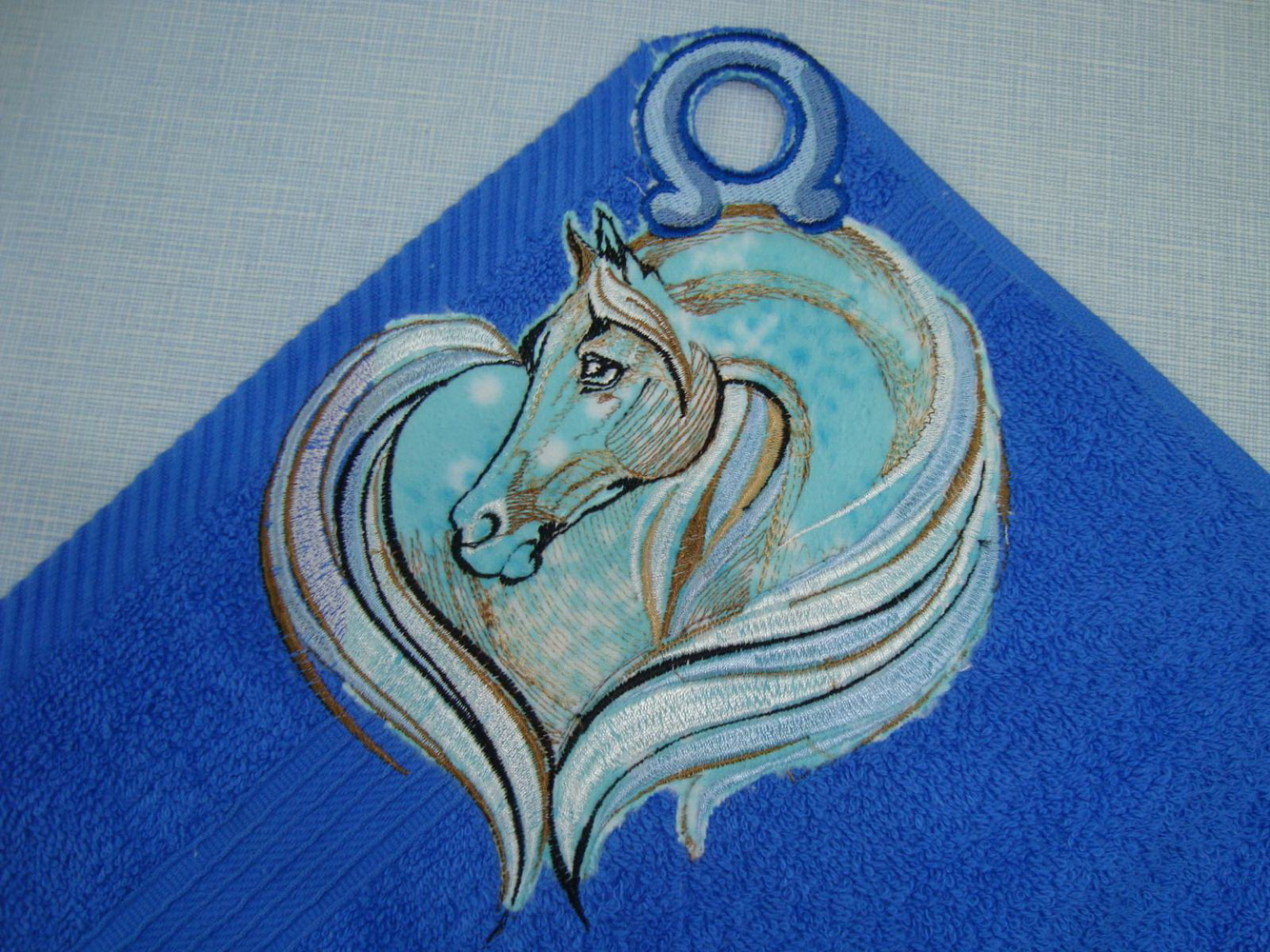 Horse design on towel embroidered
