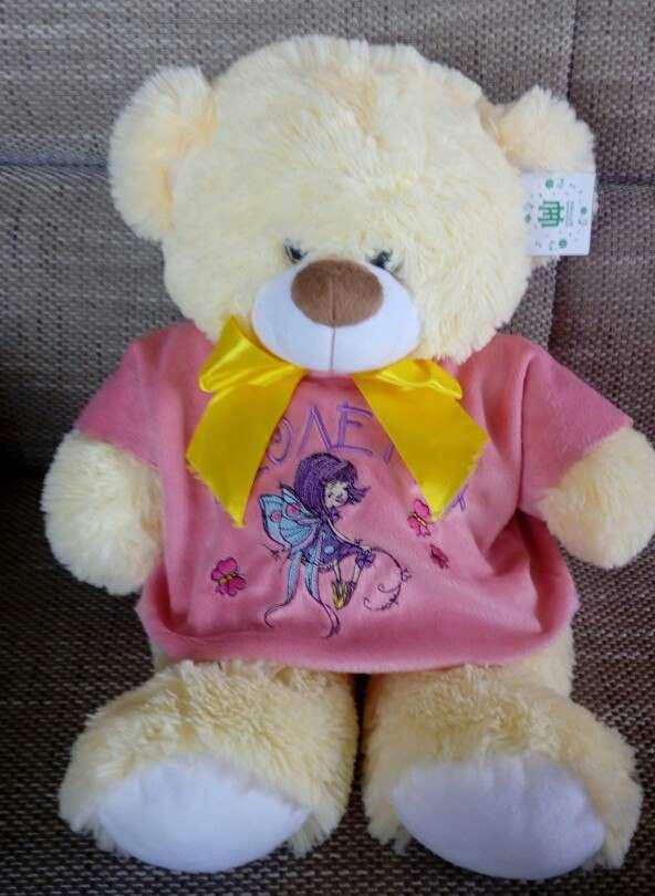 Teddy bear with young fairy embroidery design